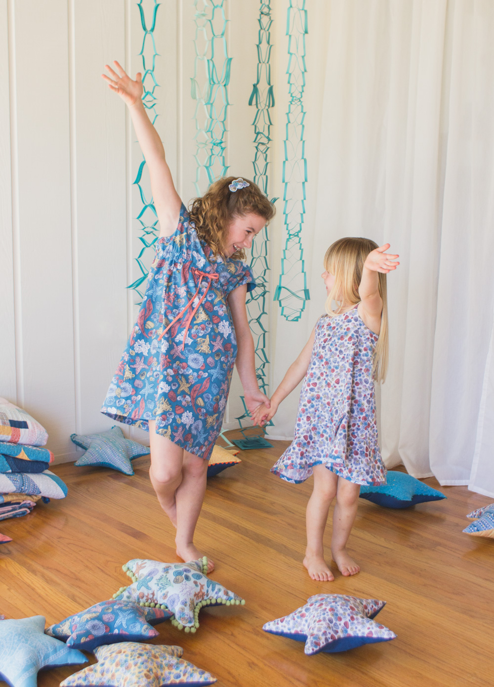 Girl on left wears Roller Skate Dress, Girl on right wears Pinwheel Slip Dress.  Sewn by Danielle Collins Photo by Danielle Collins