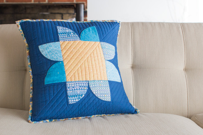 Starflower Pillow by Anne Sullivan using Quarter Circle blocks. Photo by Danielle Collins.