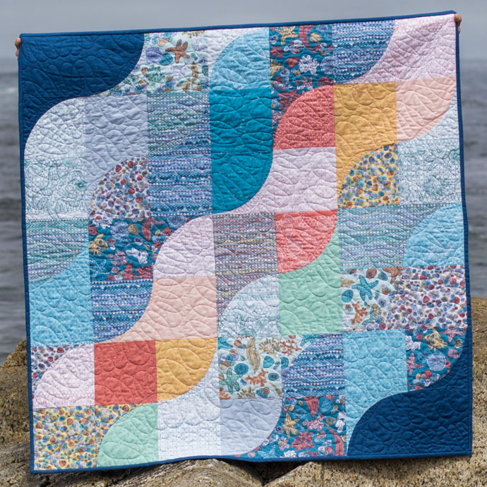 Tide Lines Quilt using Quarter Circle blocks. Photo by Danielle Collins