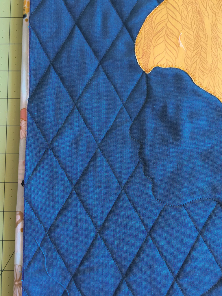 Profile stitching and background quilting.